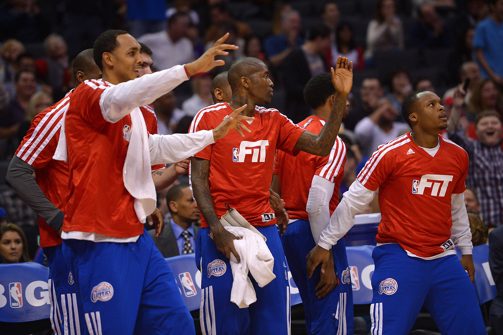 . The Clippers bench reacts to a dunk in the first half, Friday, January 10, 2014, at Staples Center. (Photo by Michael Owen Baker/L.A. Daily News)