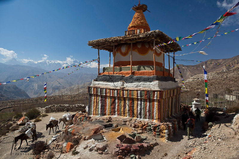Chorten with religious marking and prayer flags in Chhungar (3750m). It is 30 min walk from Tamagaon heading north. Mustang, Nepal.