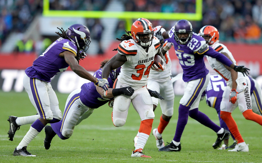 . Cleveland Browns running back Isaiah Crowell (34) runs with the ball during the second half of an NFL football game against Minnesota Vikings at Twickenham Stadium in London, Sunday Oct. 29, 2017. (AP Photo/Tim Ireland)