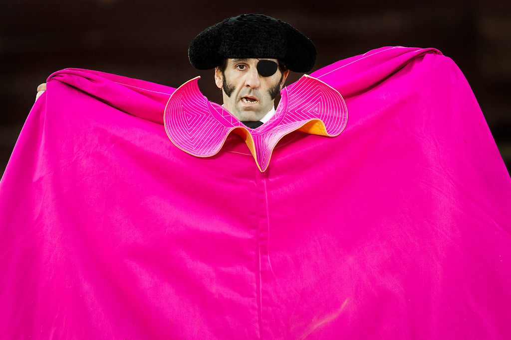 . In this March 4, 2012 photo, Spanish bullfighter Juan Jose Padilla performs during a bullfight in the southwestern Spanish town of Olivenza. This photo is one in a series of images by Associated Press photographer Daniel Ochoa de Olza that won the second place prize for the Observed Portrait series category in the World Press Photo 2013 photo contest.  (AP Photo/Daniel Ochoa de Olza, File)
