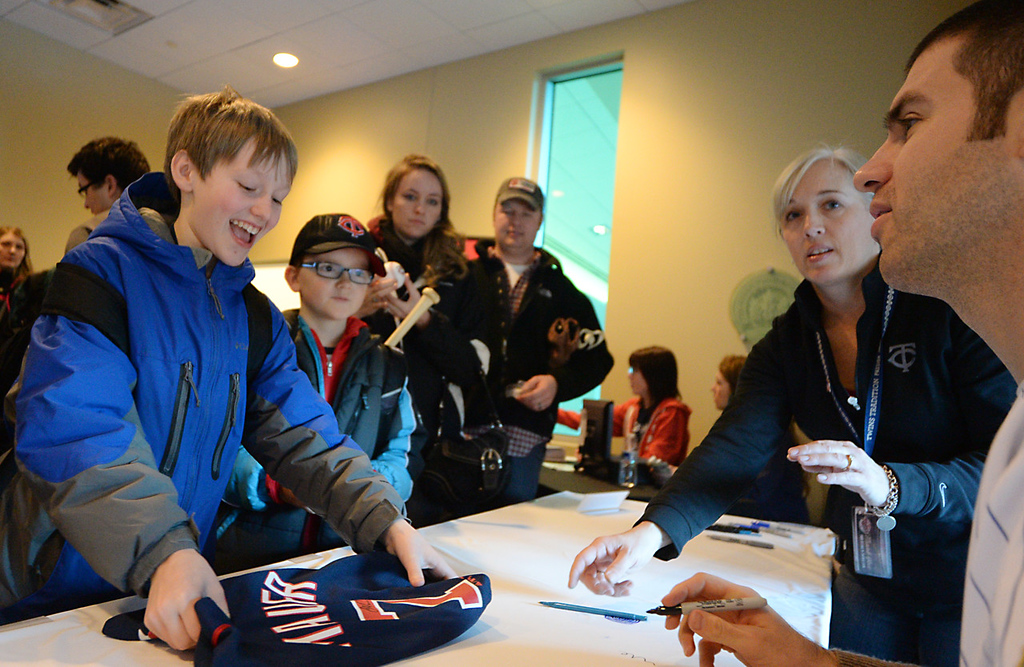 . Hunter Seaberg, 12 years-old, of South Saint Paul is very happy after Twins first baseman Joe Mauer signed his jersey at Twinsfest at Target Field, Saturday, January 25, 201. Right of Hunter is his brother Keith, 10 years-old.(Pioneer Press: John Autey)