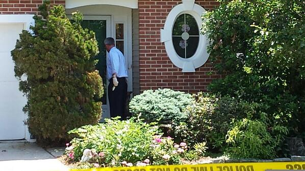 Description of . Police look at a door to a home on Harvard Drive in Montgomery Township that shows a bullet hole in the bottom right. A woman was shot and taken to an area hospital Monday, June 2, 2014. (Photo by Dan Sokil)