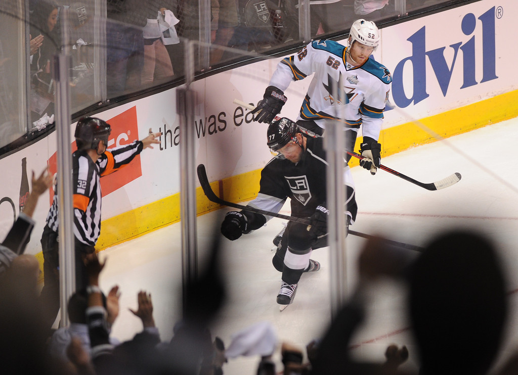 . The Kings\' Jeff Carter celebrates his first-period goal in front of the the Sharks\' Matt Irwin in game two of the second round of playoffs, Thursday, May 16, 2013, at Staples Center. (Michael Owen Baker/Staff Photographer)
