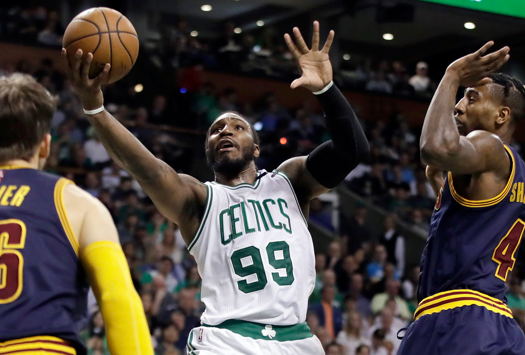 . Boston Celtics forward Jae Crowder (99) drives between Cleveland Cavaliers guards Kyle Korver, left, and Iman Shumpert, right, during first half of Game 2 of the NBA basketball Eastern Conference finals, Friday, May 19, 2017, in Boston. (AP Photo/Elise Amendola)