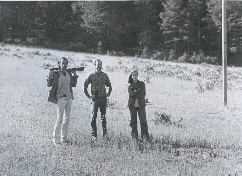 1980 - 3 people in a field, 1 with a gun.jpeg