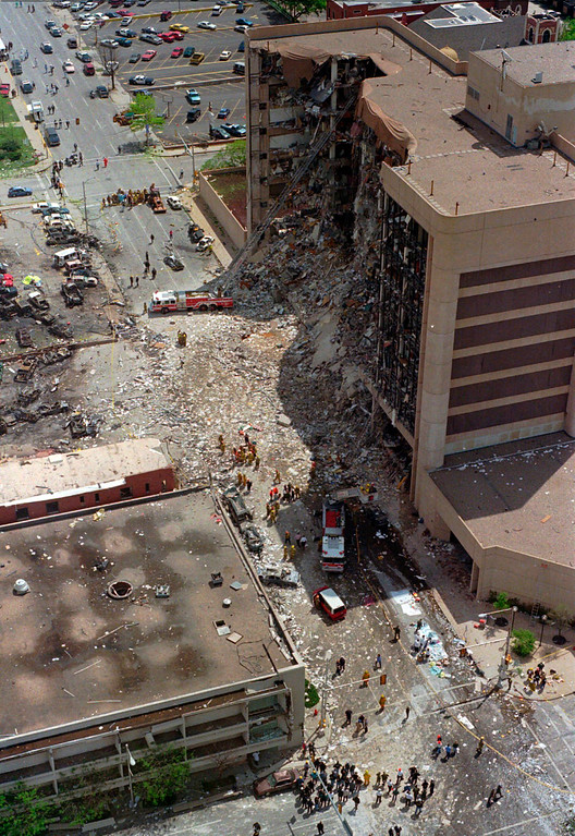 . FILE - In this April 19, 1995 file photo, rescue personnel converge on the bombed Alfred Murrah Federal Building in Oklahoma City. The blast killed 168 people - including 19 children - injured hundreds more and caused hundreds of millions of dollars in damage to structures and vehicles in the downtown area. (AP Photo/Rick Bowmer, File)