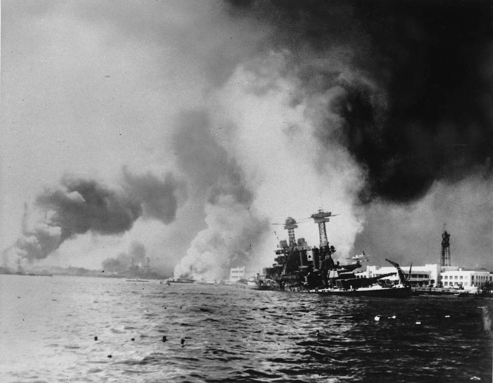 . This Dec. 7, 1941 file photo provided by the Department of Defense shows the USS California, right, after being struck by a torpedo and a 500-pound bomb during a Japanese sneak attack on Pearl Harbor.  Durrell Conner, who coded and decoded messages for the Navy, was aboard the USS California when it sank in Pearl Harbor on Dec. 7, 1941.  Conner will return with 17 family members to remember those who died in the Japanese attack 69 years ago during the Pearl Harbor Anniversary. (AP Photo/DOD)