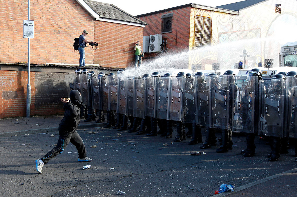 . Nationalist youths and police in riot gear clash in the Ardoyne area of north Belfast July 12, 2011. REUTERS/Cathal McNaughton