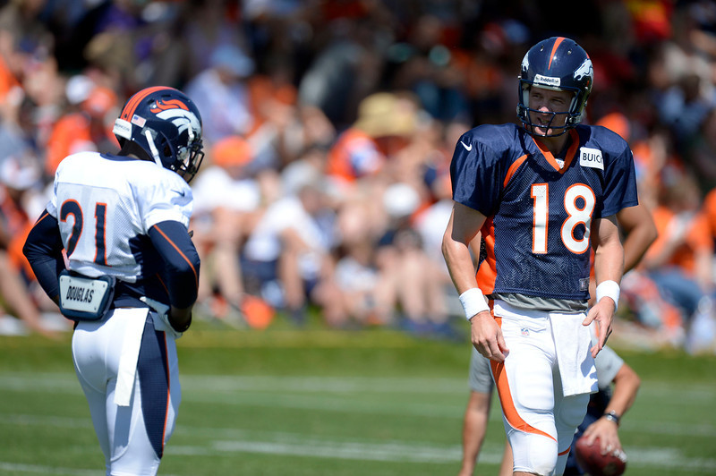 . Denver Broncos QB Peyton Manning (18) talks with RB Ronnie Hillman (21) during training camp August 12, 2013 at Dove Valley. (Photo By John Leyba/The Denver Post)