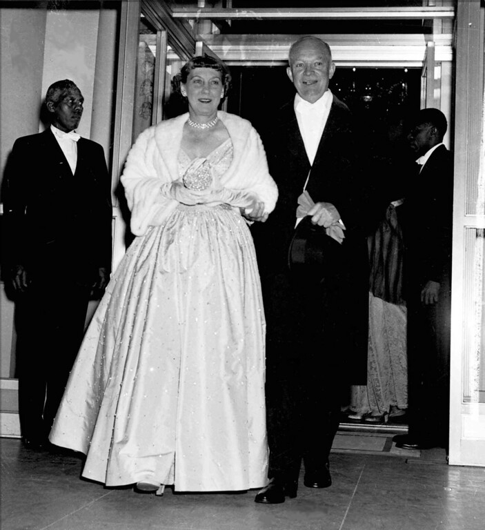 . President Dwight Eisenhower holds the arm of his wife, first lady Mamie, as they leave the White House en route to inaugural balls in Washington January 20, 1953. (AP Photo)