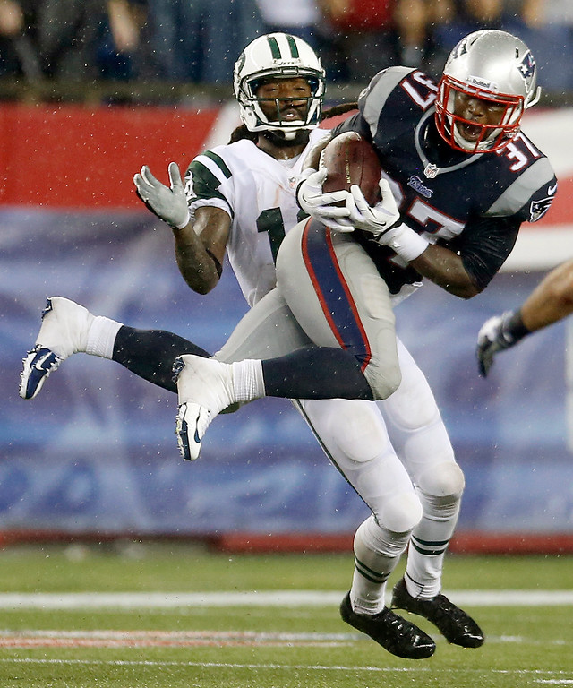 . New England Patriots cornerback Alfonzo Dennard (37) intercepts a pass intended for New York Jets wide receiver Clyde Gates, rear, during the fourth quarter of an NFL football game Thursday, Sept. 12, 2013, in Foxborough, Mass. (AP Photo/Elise Amendola)