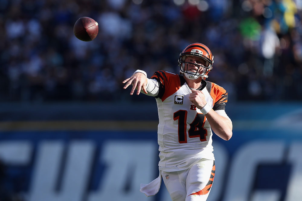 Description of . Quarterback Andy Dalton #14 of the Cincinnati Bengals throws a pass in the second half against the San Diego Chargers at Qualcomm Stadium on December 2, 2012 in San Diego, California.  (Photo by Jeff Gross/Getty Images)