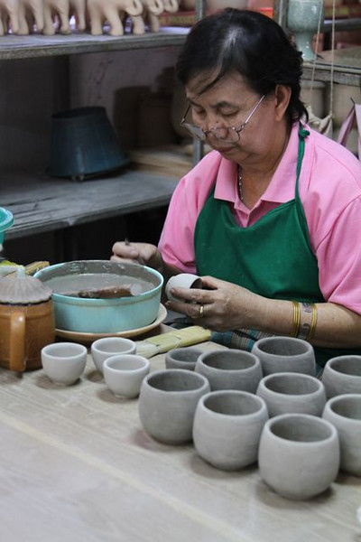 This woman was trimming and hand carving these celadon cups