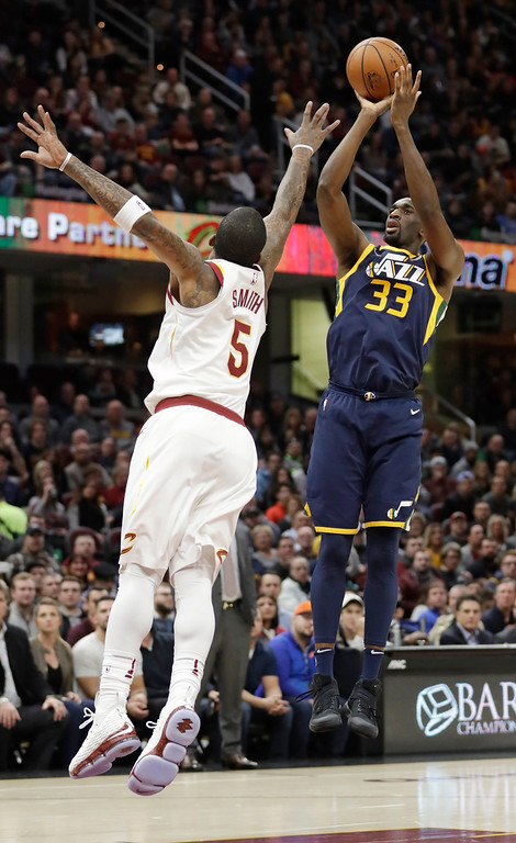 . Utah Jazz\'s Ekpe Udoh (33) shoots over Cleveland Cavaliers\' JR Smith (5) in the first half of an NBA basketball game, Saturday, Dec. 16, 2017, in Cleveland. (AP Photo/Tony Dejak)