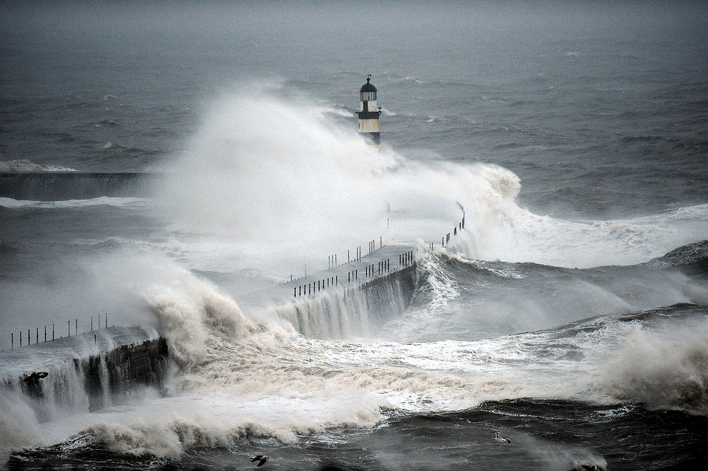 . Waves crash into the sea wall at Seaham Harbour as successive bands of heavy rain move across the British Isles, Seaham, County Durham, northern England, Thursday, Dec. 20, 2012. (AP Photo/PA, Owen Humphreys)