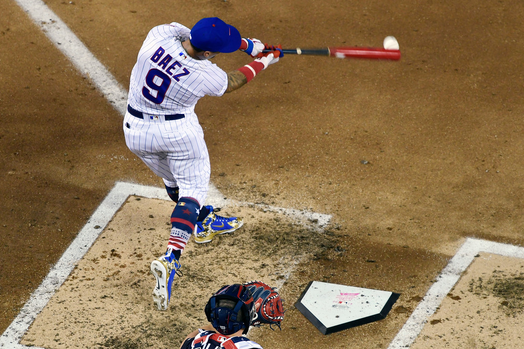 . Chicago Cubs Javier Báez (9) hits during the MLB Home Run Derby, at Nationals Park, Monday, July 16, 2018 in Washington. The 89th MLB baseball All-Star Game will be played Tuesday. (AP Photo/Susan Walsh)