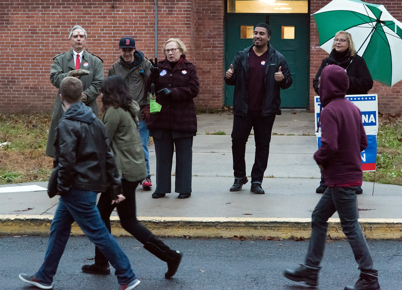11/06/18  Wesley Bunnell   Staff   Rep. Peter Tercyak, L,  State Senator Terry Gerratana and Alderman Manny Sanchez speak to voters walking into the polling location at Pulaski Middle School on Tuesday afternoon.