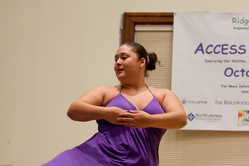 (1) Slug #: W 24464; (2) Ridgewood, NJ; (3) 10/03/09; (4) Ridgewood Community Access Network Presents Access Ridgewood on 10/3/2009; (5) Michelle, a member of the Hand-Cap Dance Company, performing at Access Ridgewood on 10/3/2009; (6) W.H. GRAE for the Ridgewood News.