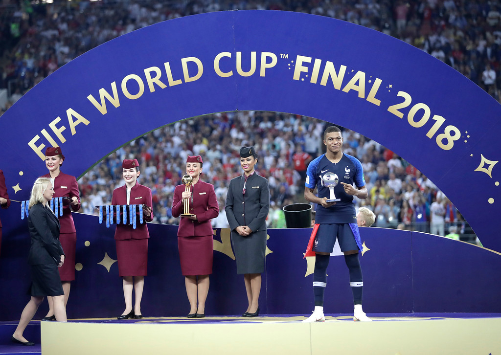 . France\'s Kylian Mbappe holds the young player of the tournament award after the final match between France and Croatia at the 2018 soccer World Cup in the Luzhniki Stadium in Moscow, Russia, Sunday, July 15, 2018. France won the final 4-2. (AP Photo/Matthias Schrader)