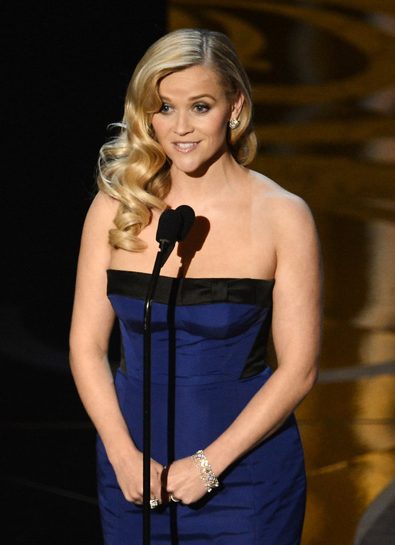 . Actress Reese Witherspoon presents onstage during the Oscars held at the Dolby Theatre on February 24, 2013 in Hollywood, California.  (Photo by Kevin Winter/Getty Images)