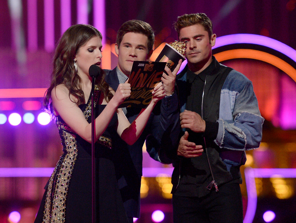 . Anna Kendrick,  from left, Adam DeVine, and Zac Efron, present the award for breakthrough performance at the MTV Movie Awards at Warner Bros. Studio on Saturday, April 9, 2016, in Burbank, Calif. (Kevork Djansezian/Pool Photo via AP)