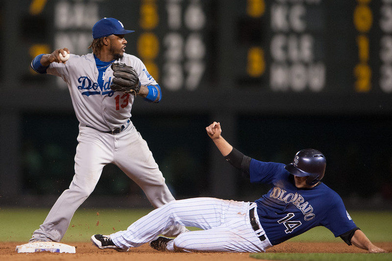 . Hanley Ramirez #13 of the Los Angeles Dodgers forces out Josh Rutledge #14 of the Colorado Rockies at second base in the third inning of a game at Coors Field on September 15, 2014 in Denver, Colorado.  (Photo by Dustin Bradford/Getty Images)