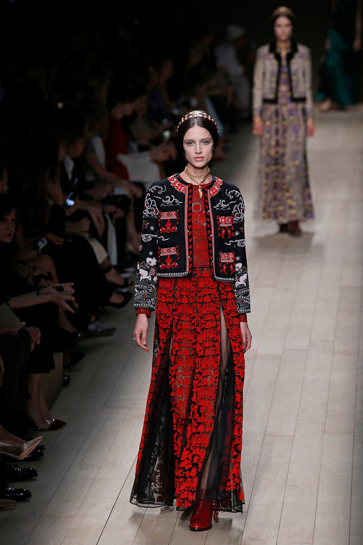 . A model presents a creation as part of Valentino\'s ready-to-wear Spring/Summer 2014 fashion collection, presented Tuesday, Oct. 1, 2013 in Paris. (AP Photo/Christophe Ena)