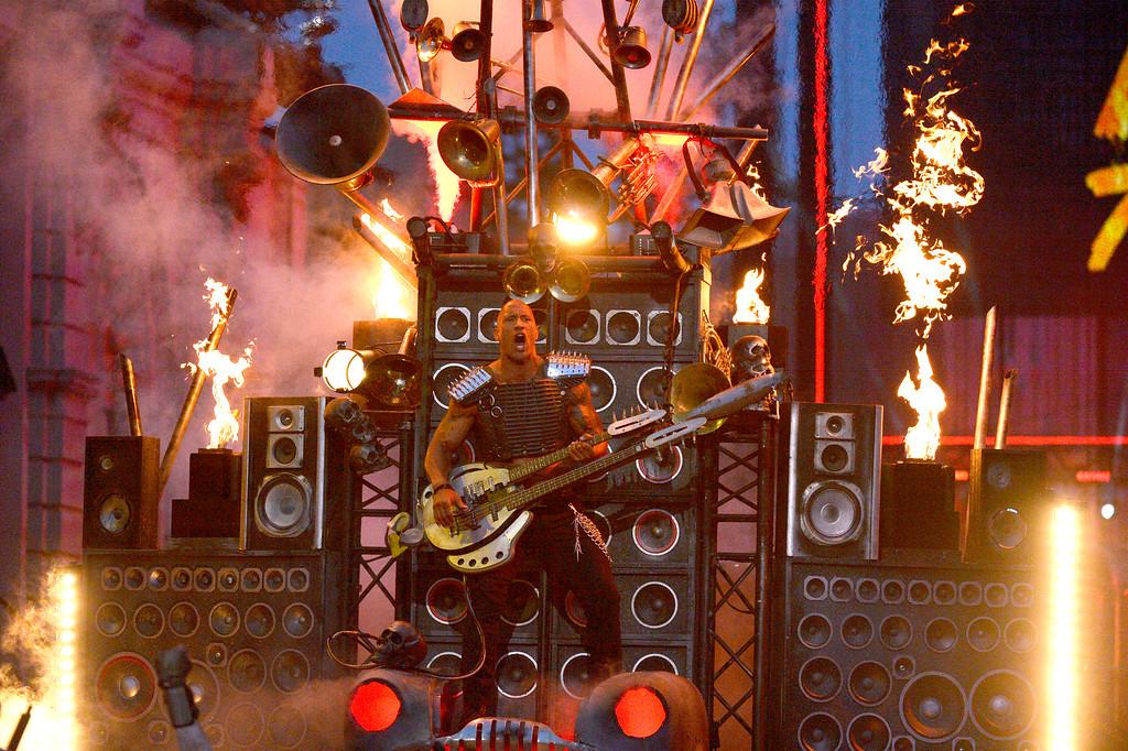 . Host Dwayne Johnson performs on stage at the MTV Movie Awards at Warner Bros. Studio on Saturday, April 9, 2016, in Burbank, Calif. (Kevork Djansezian/Pool Photo via AP)