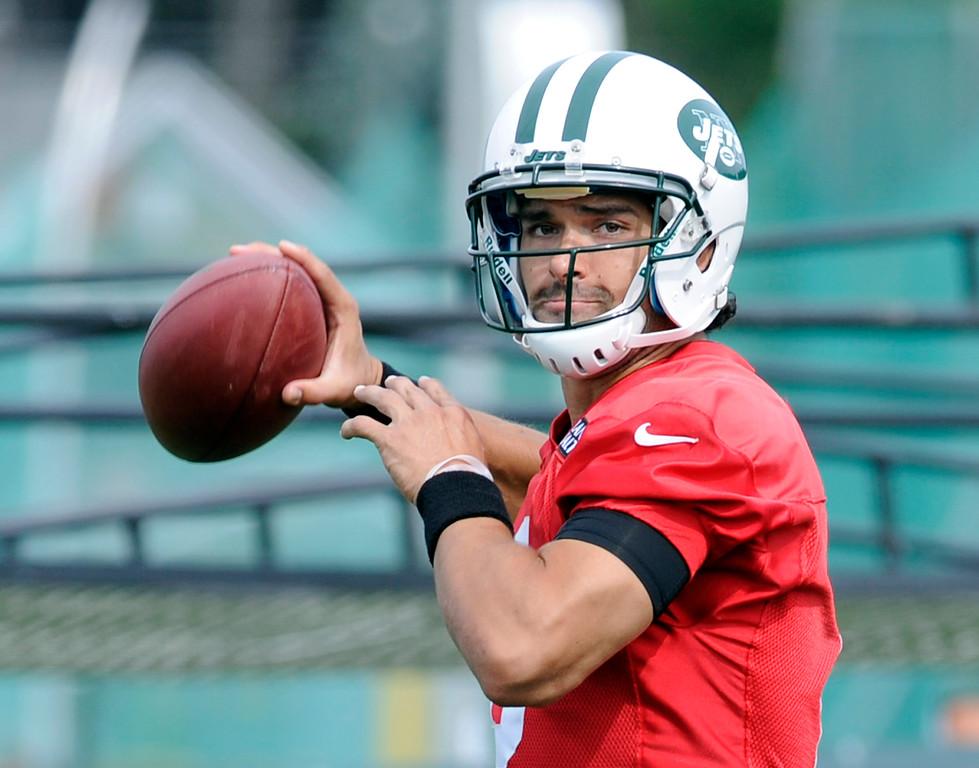 . New York Jets quarterback Mark Sanchez looks to pass at NFL football training camp Saturday, July 27, 2013, in Cortland, N.Y. (AP Photo/Bill Kostroun)