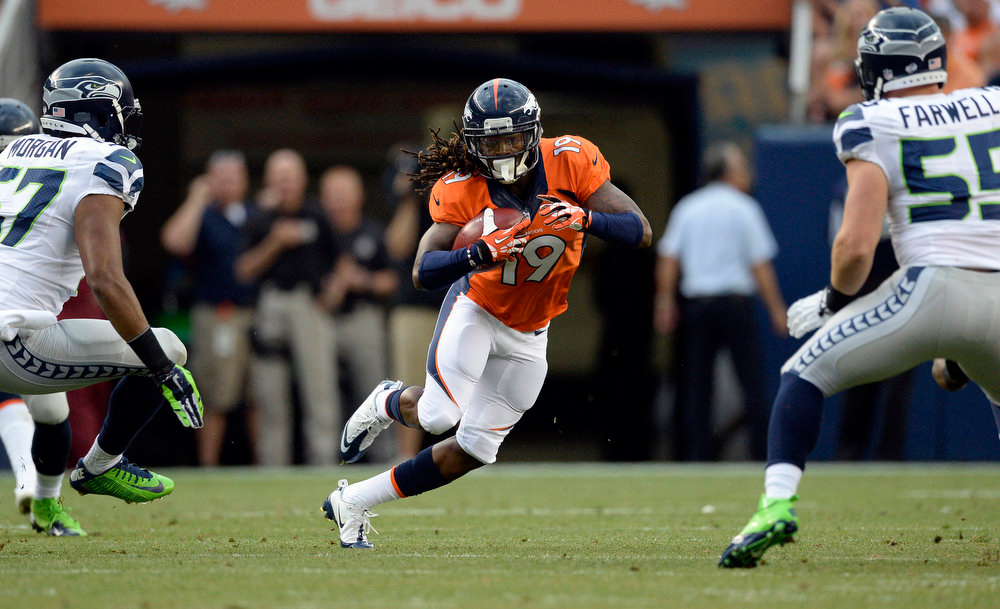 . Wide receiver Isaiah Burse (19) of the Denver Broncos looks for an opening during the first quarter of the game.  The Denver Broncos vs the Seattle Seahawks At Sports Authority Field at Mile High. (Photo by John Leyba/The Denver Post)