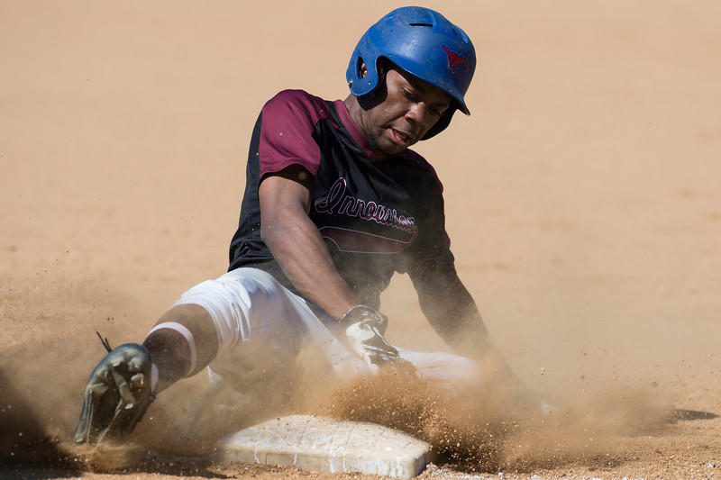 05/21/19  Wesley Bunnell | Staff  Innovation baseball defeated MLC on Tuesday afternoon at New Britain Stadium. Melvin Saylor (5) slides safely into third base.