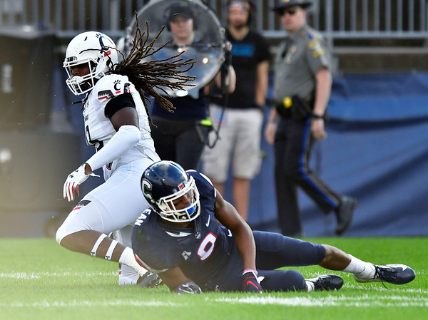9/29/2018 Mike Orazzi | Staff Cincinnati's Michael Pitts and UConn's Aaron Mclean (8) during Saturday football game.