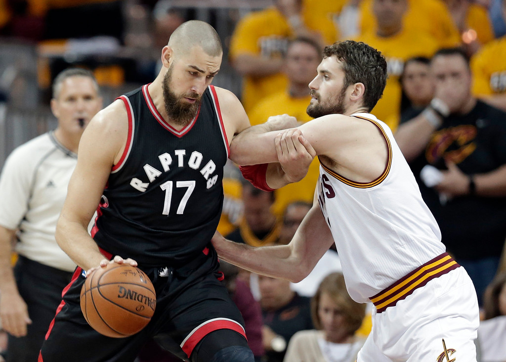 . Toronto Raptors\' Jonas Valanciunas (17), from Lithuania, drives past Cleveland Cavaliers\' Kevin Love (0) in the first half in Game 1 of a second-round NBA basketball playoff series, Monday, May 1, 2017, in Cleveland. (AP Photo/Tony Dejak)