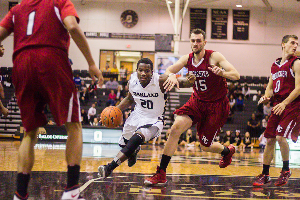 . Felder pushes through the Rochester College defense for a lay-up attempt. Photo by Dylan Dulberg