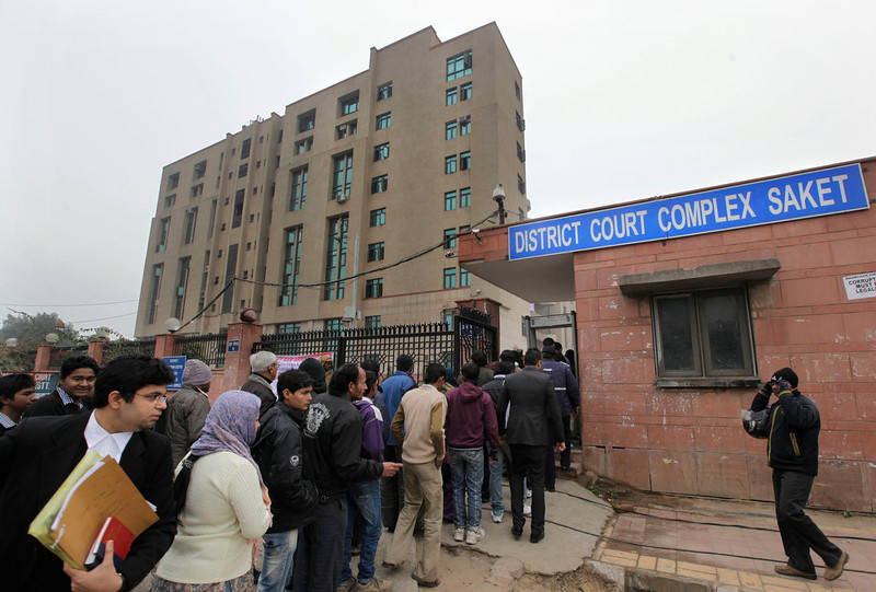 . Indians stand in a queue to enter the District Court complex where a new fast-track court was inaugurated Wednesday to deal specifically with crimes against women, in New Delhi, India, Thursday, Jan. 3, 2013. Indian police were preparing Thursday to file rape and murder charges against a group of men accused of sexually assaulting a 23-year-old university student for hours on a moving bus in New Delhi. The Dec. 16 attack on the woman, who later died of her injuries, has caused outrage across India, sparking protests and demands for tough new rape laws, better police protection for women and a sustained campaign to change society\'s views about women. (AP Photo/ Manish Swarup)