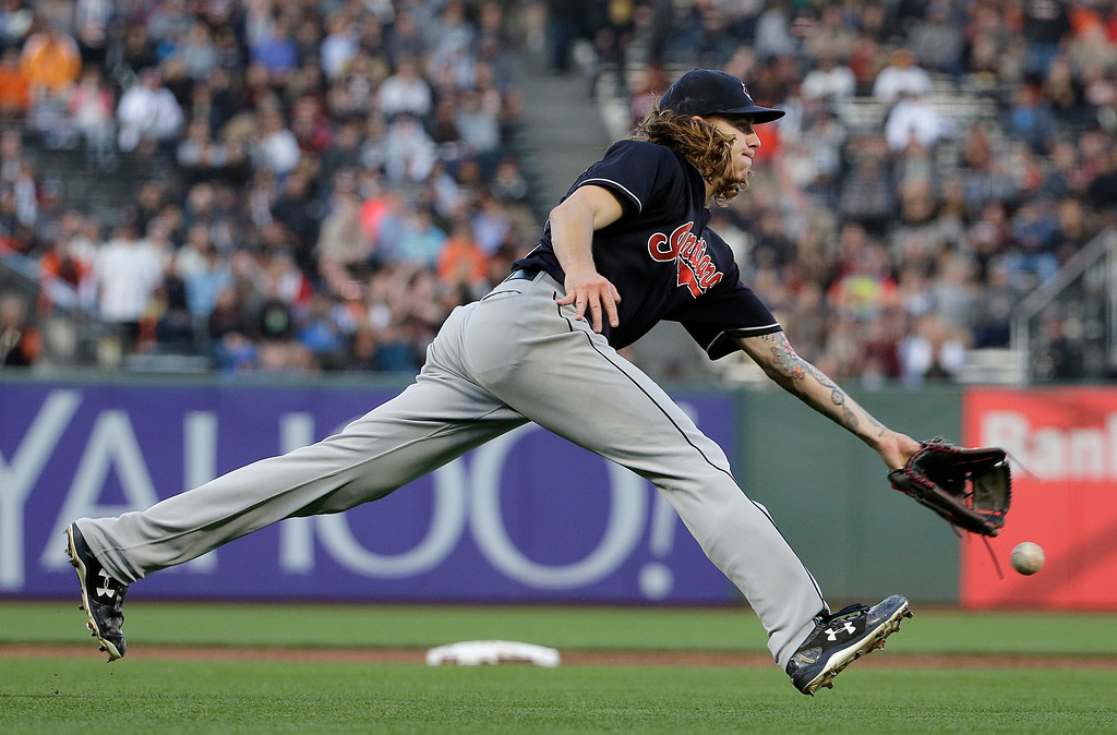. Cleveland Indians pitcher Mike Clevinger flips the ball to first base for the out on San Francisco Giants\' Hunter Pence during the second inning of a baseball game in San Francisco, Tuesday, July 18, 2017. (AP Photo/Jeff Chiu)