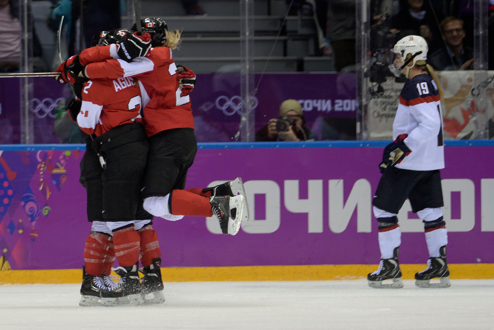 . Team Canada celebrates with Marie-Philip Poulin (29) after she tied the game 2-2 on against the U.S.A. during the third period of the women\'s gold medal ice hockey game. Sochi 2014 Winter Olympics on Thursday, February 20, 2014 at Bolshoy Ice Arena. (Photo by AAron Ontiveroz/ The Denver Post)