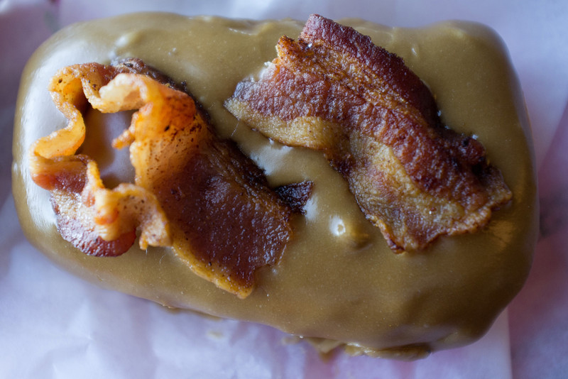 Bacon Maple Bar, raised yeast doughnut with maple frosting and bacon on top!
