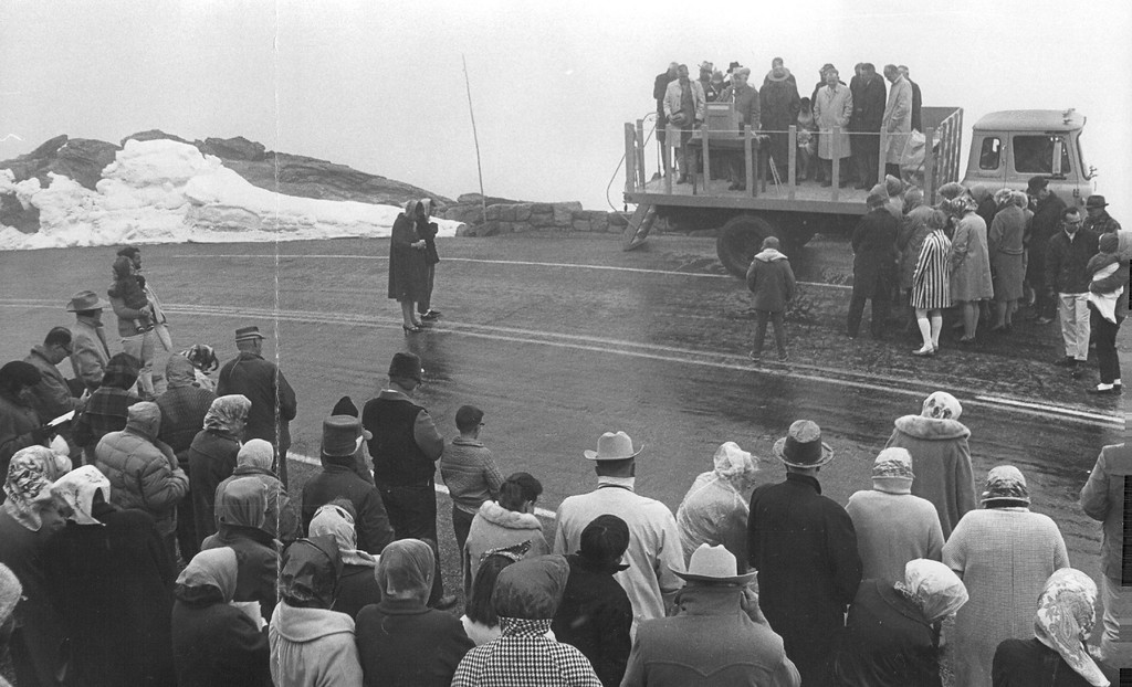. With bowed heads, crowd of hardy travelers are at ceremonies atop Trail Ridge Road in Rocky Mountain National Park. They heard D. Ned Linegar, manager of Estes Park Chamber of Commerce, give invocation at ceremonies reopening nation\'s highest continuous, highway in 1966. (Ira Gay Sealy/The Denver Post)