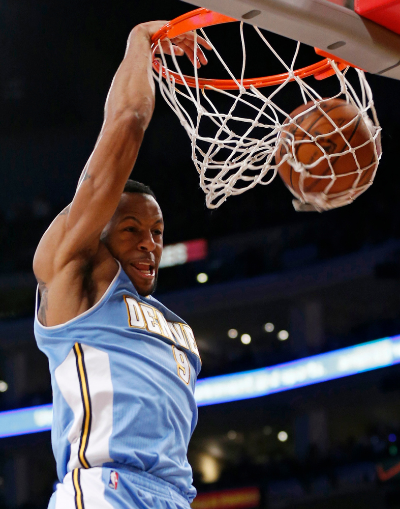 . Denver Nuggets\' Andre Iguodala dunks the ball against the Los Angeles Lakers during the first half of their NBA basketball game in Los Angeles January 6, 2013. REUTERS/Danny Moloshok