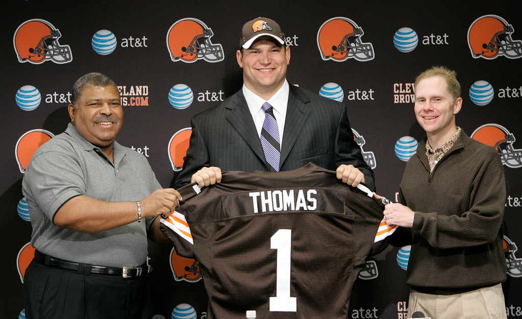 . Cleveland Browns head coach Romeo Crennel, left to right, Joe Thomas, and general Manager Phil Savage, pose with a jersey, Sunday, April 29, 2007, in Berea, Ohio.  The Browns selected Wisconsin tackle Joe Thomas as the number three pick in the first round of the 2007 NFL Draft. (AP Photo/Tony Dejak)