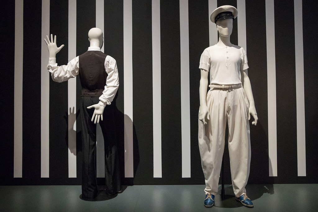 """. The suit from the \""""Thin White Duke\"""" from the \""""Station to Station\"""" tour designed by Ola Hudson, left, and the Naval-style costume from the \""""Stage Tour\"""" designed by Natasha Korniloff are on display during the media preview of the \""""David Bowie is\"""" exhibit at the Brooklyn Museum, Wednesday, Feb. 28, 2018, in New York. The exhibit opens to the public on March 2 and runs through July 15. (AP Photo/Mary Altaffer)"""