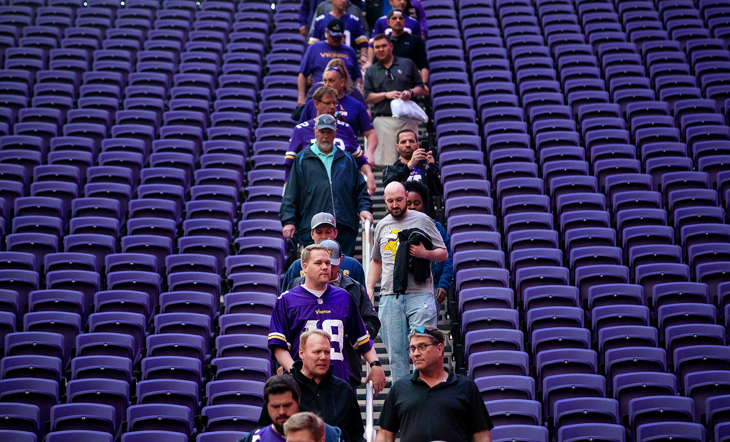 . Fans walk down to the field level at the Minnesota Vikings\' NFL football draft party Thursday, April 26, 2018, in Minneapolis. (Carlos Gonzalez/Star Tribune via AP)