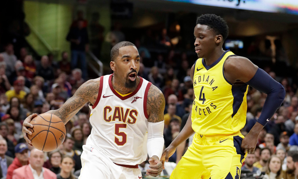 . Cleveland Cavaliers\' JR Smith (5) drives against Indiana Pacers\' Victor Oladipo (4) during the first half of an NBA basketball game Friday, Jan. 26, 2018, in Cleveland. (AP Photo/Tony Dejak)
