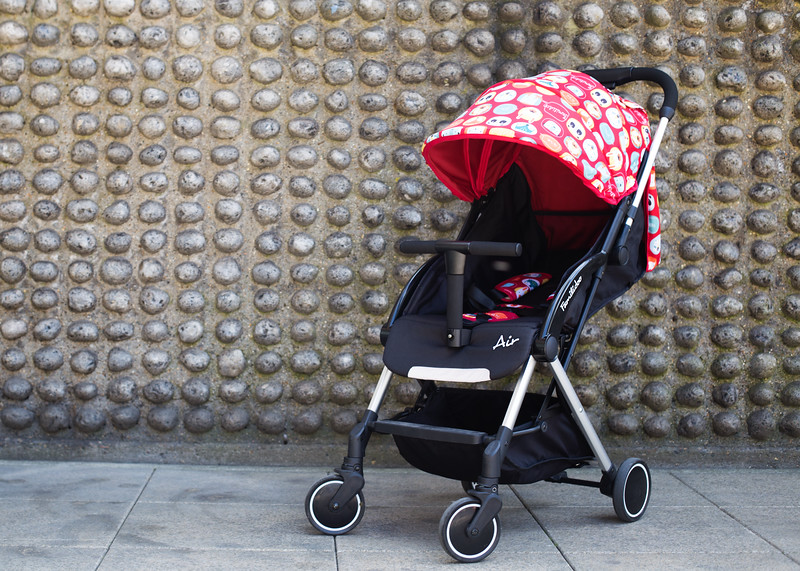Familidoo_Air_Lifestyle_Pink_Rabbit_Pushchair_Beside_Concrete_Wall.jpg