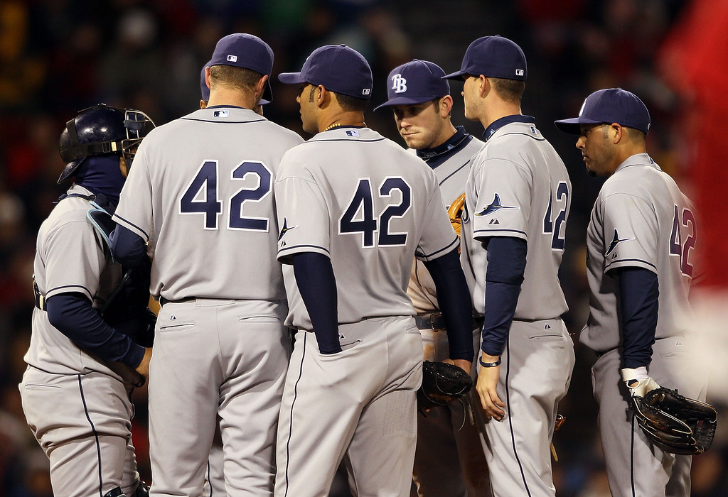 . BOSTON - APRIL 16:  The Tampa Bay Rays gather on the pitchers mound in the fourth inning against the Boston Red Sox on April 16, 2010 at Fenway Park in Boston, Massachusetts. The Tampa Bay Rays wore the number 42 to honor Jackie Robinson. (Photo by Elsa/Getty Images)