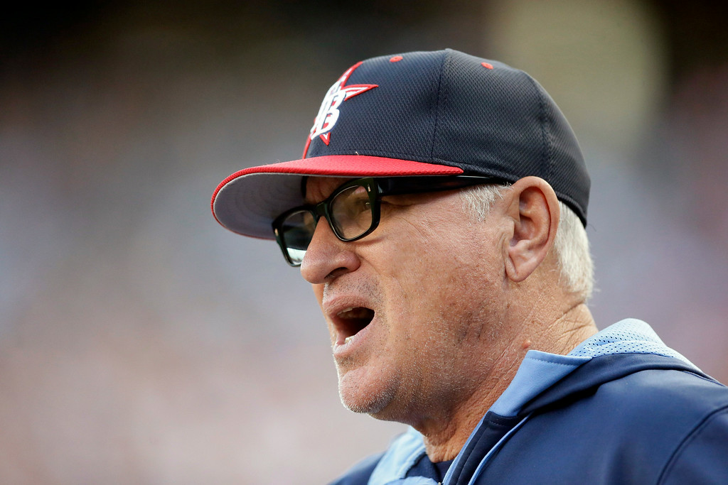 . Tampa Bay Rays manager Joe Maddon looks on from the dugout during the first inning of a baseball game against the Detroit Tigers in Detroit, Friday, July 4, 2014. (AP Photo/Carlos Osorio)