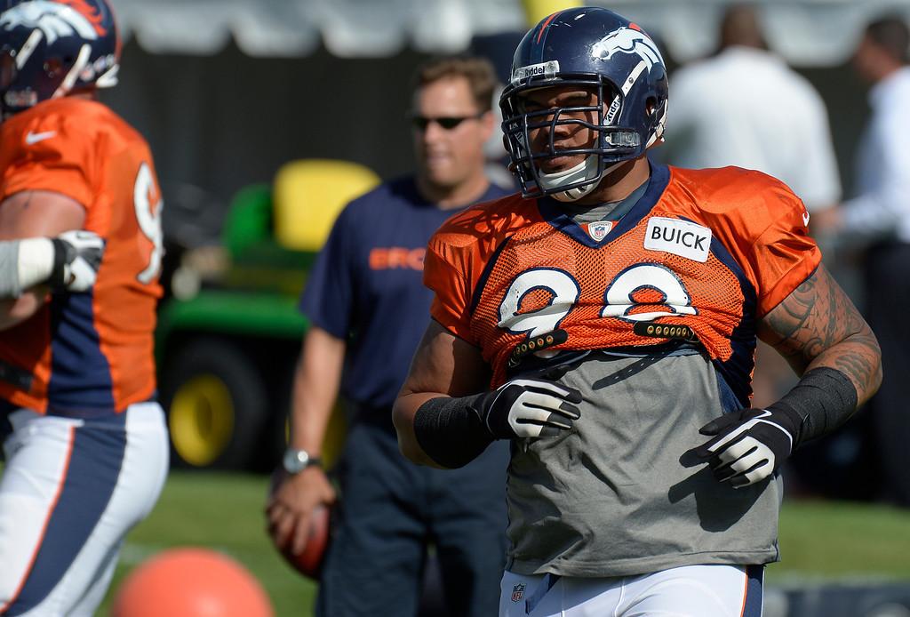 . Denver Broncos DT Sealver Siliga (98) runs through drills during training camp August 6, 2013 at Dove Valley. (Photo By John Leyba/The Denver Post)