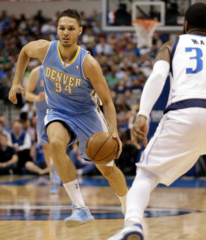 . Denver Nuggets shooting guard Evan Fournier (94), of France, dribbles the ball against Dallas Mavericks O.J. Mayo during the first half of an NBA basketball game on Friday, April 12, 2013, in Dallas. (AP Photo/LM Otero)