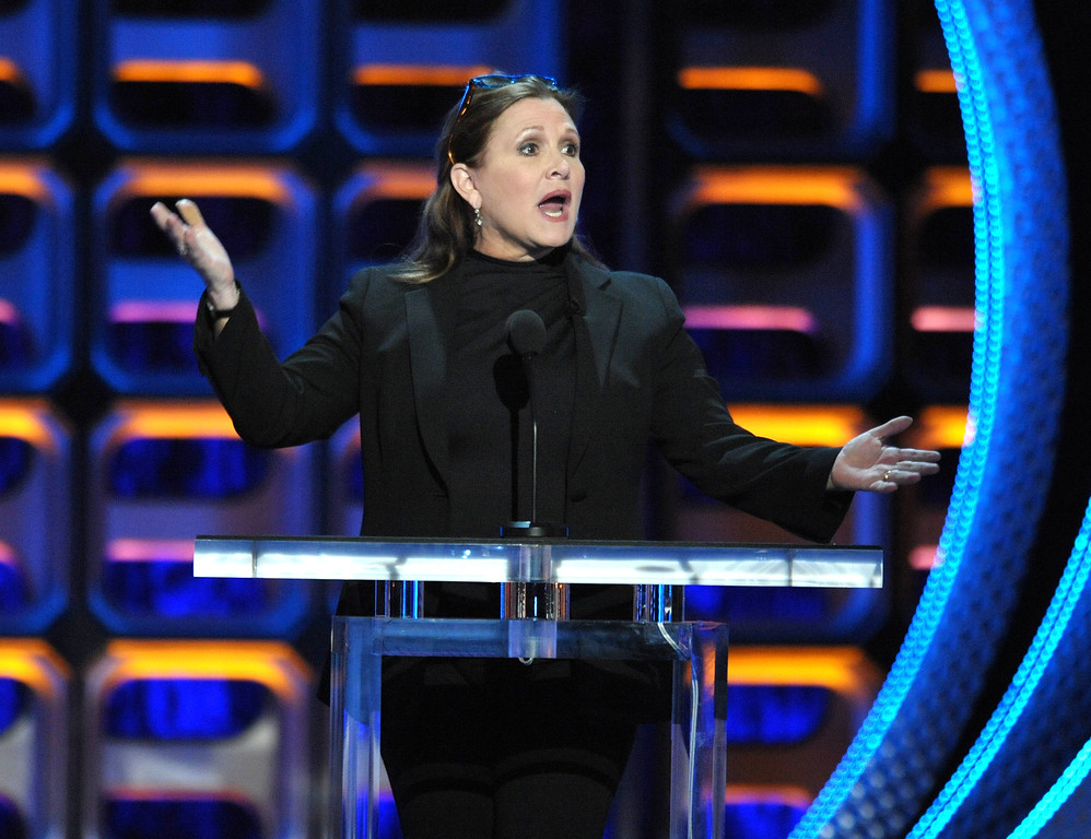 """. Carrie Fisher appears on stage at the Comedy Central \""""Roast of Roseanne\"""" at the Hollywood Palladium on Saturday, Aug. 4, 2012, in Los Angeles. (Photo by John Shearer/Invision/AP)"""